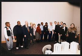 Group portrait of fourteen men and women at an Employee Service Awards Ceremony.