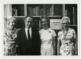 Group portrait of Gertrude L. Annan, Bernard Becker, Janet Becker, and Estelle Brodman posed in f...
