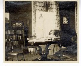 Woman seated at a desk.