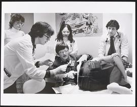 Dr. Vita Land examining a patient with a group of students, Department of Pediatrics, Washington ...