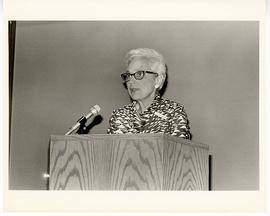 Estelle Brodman giving an address from a podium at the Max A. Goldstein rare book collection at t...