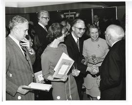 "Group of men and women at a reception honoring the publication of Park J. White's book, ""Ver..."