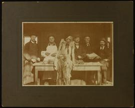 Group portrait of Robert C. Milburn and four unidentified men posing with their dissected cadaver...