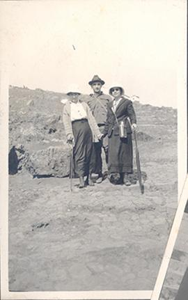 Group portrait of June Steven and an unidentified man and woman dressed for hiking, China.
