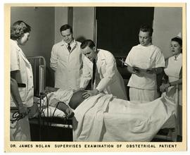 James Nolan supervising the examination of an obstetrical patient.