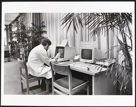 Unidentified doctor using a computer in the library, Washington University School of Medicine.