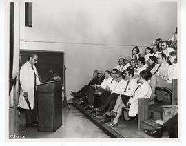 Lawrence Kahn giving a lecture in the St. Louis Children's Hospital ampitheater.