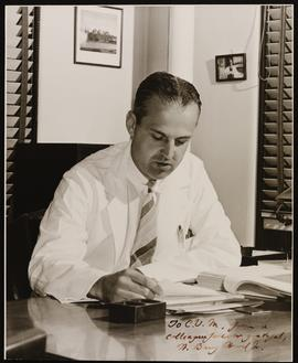 Portrait of W. Barry Wood, Jr. at his desk.