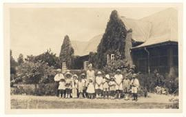 Group portrait of children, including the Cowdry children, outside the Cowdry home, Onderstepoort...