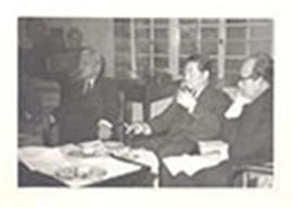 Drs. Takizawa, Yoshida, and Nakahara seated in a living room, Japan.