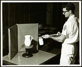 Student spray painting a ceramic jug, Washington University School of Medicine, Program in Occupa...