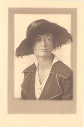 Studio portrait of Alice Cowdry wearing a hat.