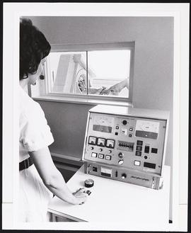 Radiographer at the control unit of the EMI-Scanner at Atkinson Morley's Hospital, Wimbledon, Lon...
