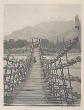Wooden bridge over a river, China.