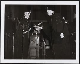 Abraham Flexner receiving an honorary medical degree from Arthur H. Compton on the 50th anniversa...