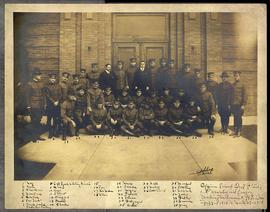 Group portrait of 35 men posed in front of a doorway, likely the entrance to the Refrectory, Wash...
