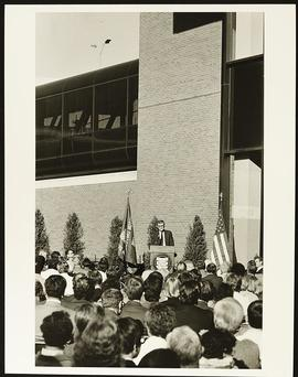 William H. Danforth speaking from the podium at the Cancer Research Building Dedication ceremony.