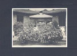 Building exterior and blooming bushes, Peking Union Medical College, China.