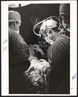 Surgeons operating on the brain of an epilepsy patient.