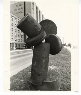 View of a sculpture in the median of Kingshighway Blvd. with St. Louis Children's Hospital visibl...