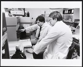 Dr. Gregory Grant and Marc Eichler in Grant's laboratory, Department of Biochemistry, Washington ...