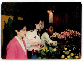 Students manning a flower sale booth, Washington University School of Medicine, Program in Occupa...