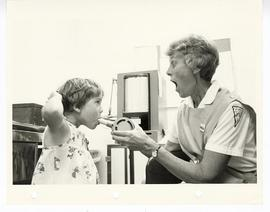 Speech therapist working with a young girl, St. Louis Children's Hospital.
