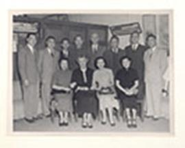 Group portrait of E.V. and Alice Cowdry, Dr. and Mrs. Liang, and eight unidentified men and women...