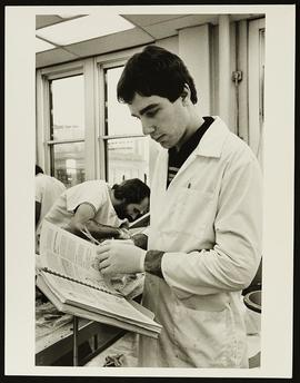 Student preparing for dissection in a laboratory, Department of Anatomy, Washington University Sc...