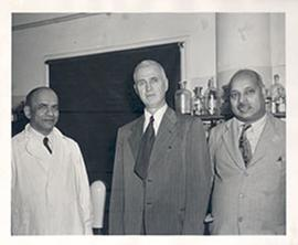 Group portrait of Dr. V.R. Kaholkar, E.V. Cowdry, and Dr. K.C.K.E. Raja in a laboratory in India.