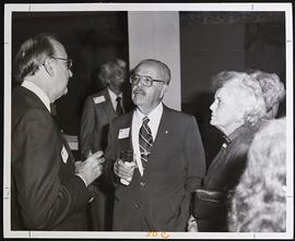 Paul E. Lacy conversing with Dr. and Mrs. Frank Drake, Denver Reception.