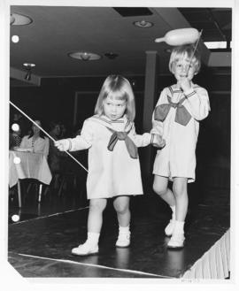 Young girl and boy in sailor outfits on the runway at a St. Louis Children's Hospital Auxiliary A...