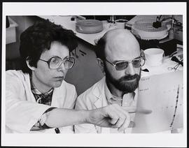 Jacques Baenzinger and an unidentified woman at work in a laboratory.