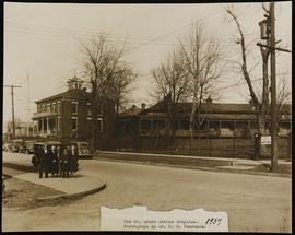 Group portrait of five men and women standing outside of St. Louis Marine Hospital.