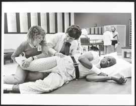 Dr. Shirley A. Sahrmann and a staff member working with a patient, Washington University School o...