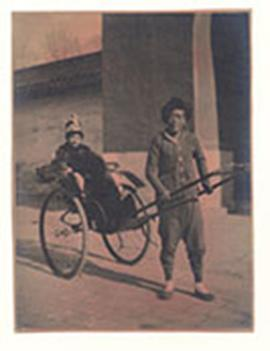 Alice Cowdry riding in a rickshaw, China.