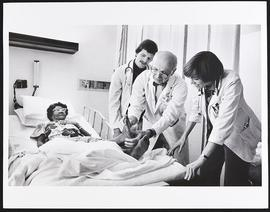 Dr. William Daughaday examining a patient with students Pat Winokur and Bill Thompson, Department...