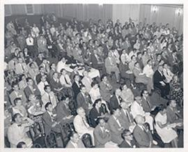 Overhead view of audience participants seated in an auditorium for the Fourth International Cance...