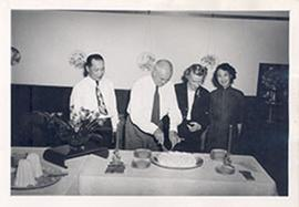 E.V. and Alice Cowdry cutting a cake at General Loo's house, Taipei, Taiwan.
