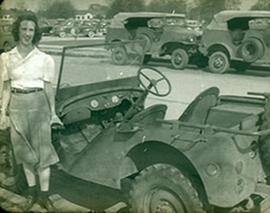 "Margaret ""Willie"" Beumer posed next to a jeep, Fort Benning, Georgia."