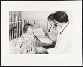 Unidentified student and Lawrence Gassner examining a patient, Department of Pediatrics, Washingt...