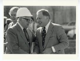 C. Alvin Tolin in a hard hat and two unidentified men.