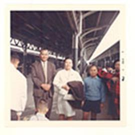 Group portrait of Dr. and Mrs. Tsai with their youngest son at a train station, Taiwan.