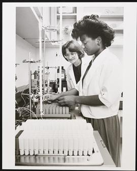 Sherida Tollefson and Stephanie Talton work in a laboratory.
