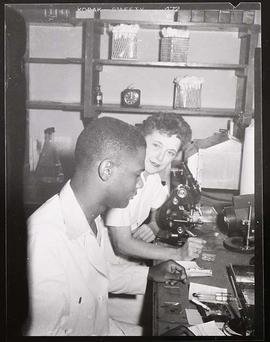 Jean Cineas and Vera Romike working in a laboratory, Jewish Hospital.