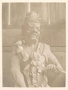Sulpture of a grimacing man, Tibetan borderlands.