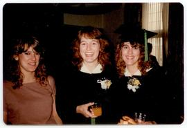 Group portrait of three women at a graduation afterparty, Washington University School of Medicin...