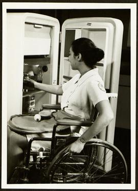 Student retrieving items from a refrigerator, Washington University School of Medicine, Program i...