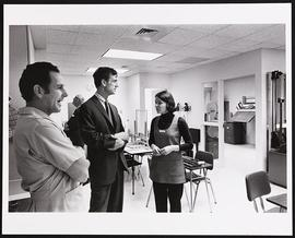 William H. Danforth conversing with staff of the Irene Walter Johnson Rehabilitation Institute.