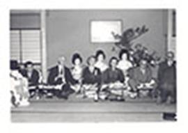 E.V. and Alice Cowdry seated with other men and women at a dinner, Tokyo, Japan.